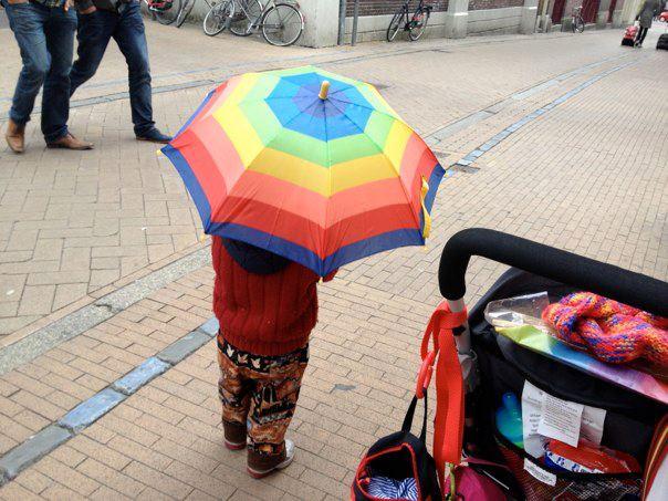 T with rainbow umbrella